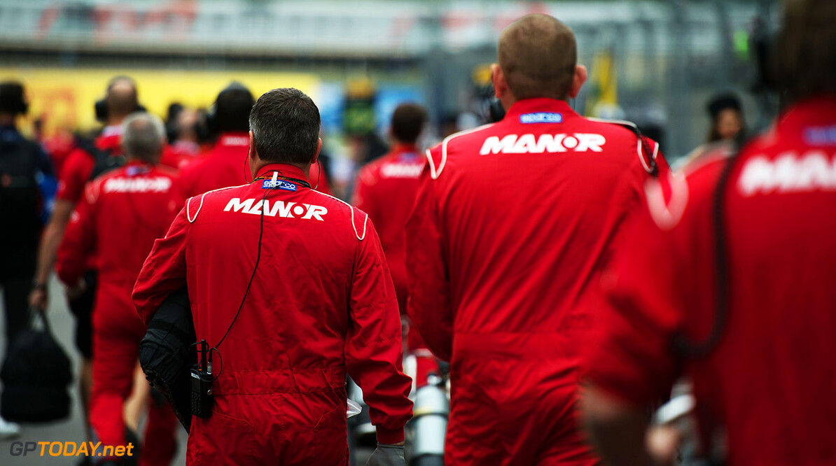 Formula One World Championship Manor Marussia F1 Team mechanics on the grid.