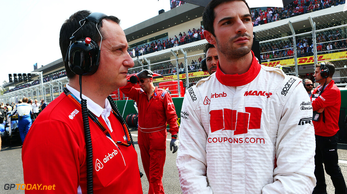 Formula One World Championship Alexander Rossi (USA) Manor Marussia F1 Team on the grid with Gianluca Pisanello (ITA) Manor Marussia F1 Team Chief Engineer.