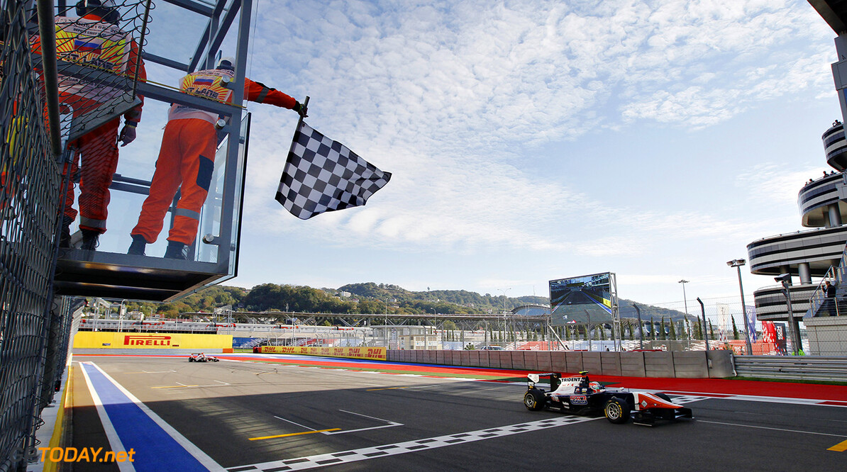 2015 GP3 Series Round 7.  Sochi Autodrom, Sochi, Russia  Sunday 11 October 2015. Luca Ghiotto (ITA, Trident) takes the chequered flag and the win. Photo: Sam Bloxham/GP3 Series Media Service.  ref: Digital Image _G7C7546      sunday race one action