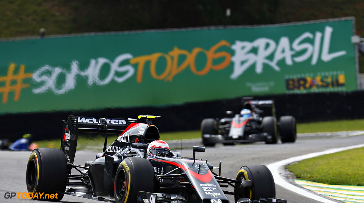 Jenson Button leads Fernando Alonso.