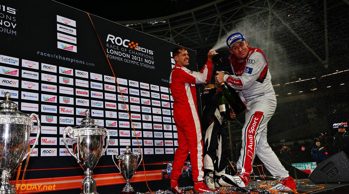 2015 Race of Champions, Olympic Park, London Sebastian Vettel (GER) celebrates on the podium with Tom Kristensen (DMK)      portrait