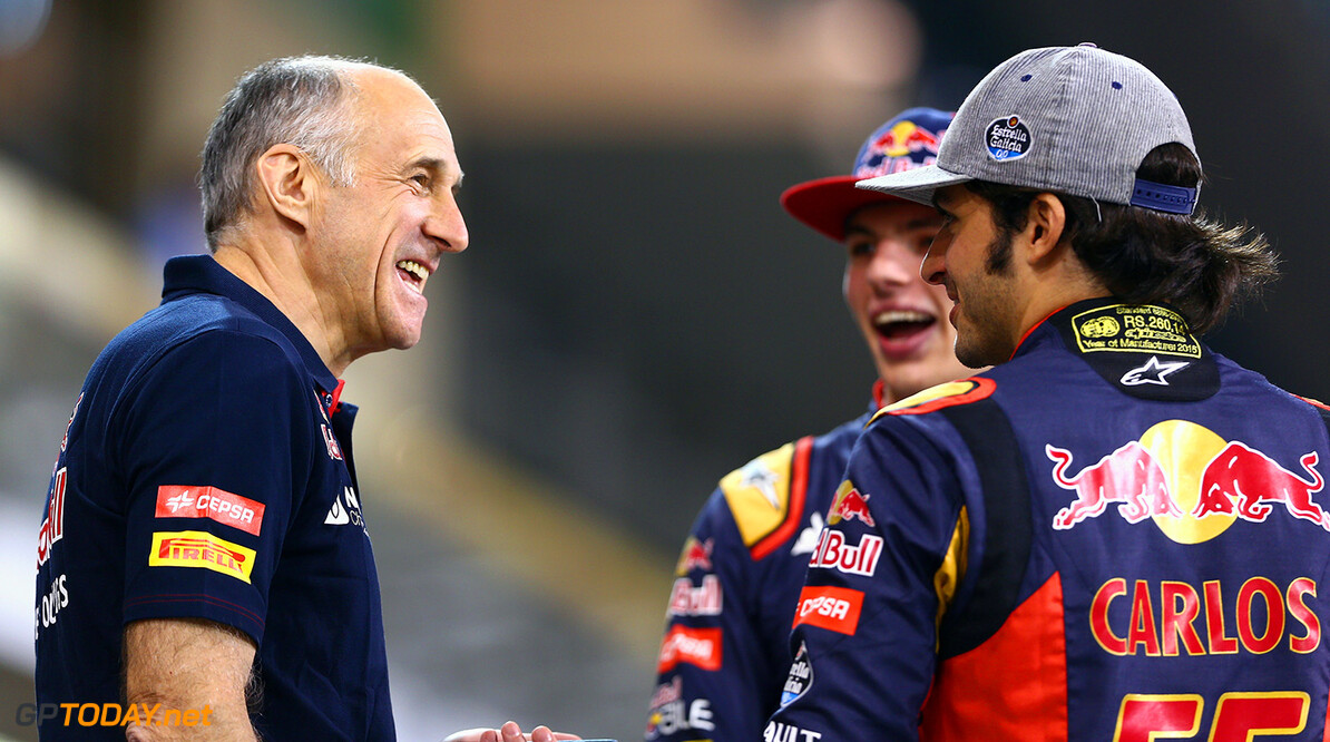 ABU DHABI, UNITED ARAB EMIRATES - NOVEMBER 26:  Max Verstappen of Netherlands and Scuderia Toro Rosso speaks with Carlos Sainz of Spain and Scuderia Toro Rosso and Scuderia Toro Rosso Team Principal Franz Tost as they wait in the pit lane for a team photograph during previews for the Abu Dhabi Formula One Grand Prix at Yas Marina Circuit on November 26, 2015 in Abu Dhabi, United Arab Emirates.  (Photo by Clive Mason/Getty Images) // Getty Images/Red Bull Content Pool // P-20151126-00355 // Usage for editorial use only // Please go to www.redbullcontentpool.com for further information. //  F1 Grand Prix of Abu Dhabi - Previews Clive Mason Abu Dhabi United Arab Emirates  P-20151126-00355