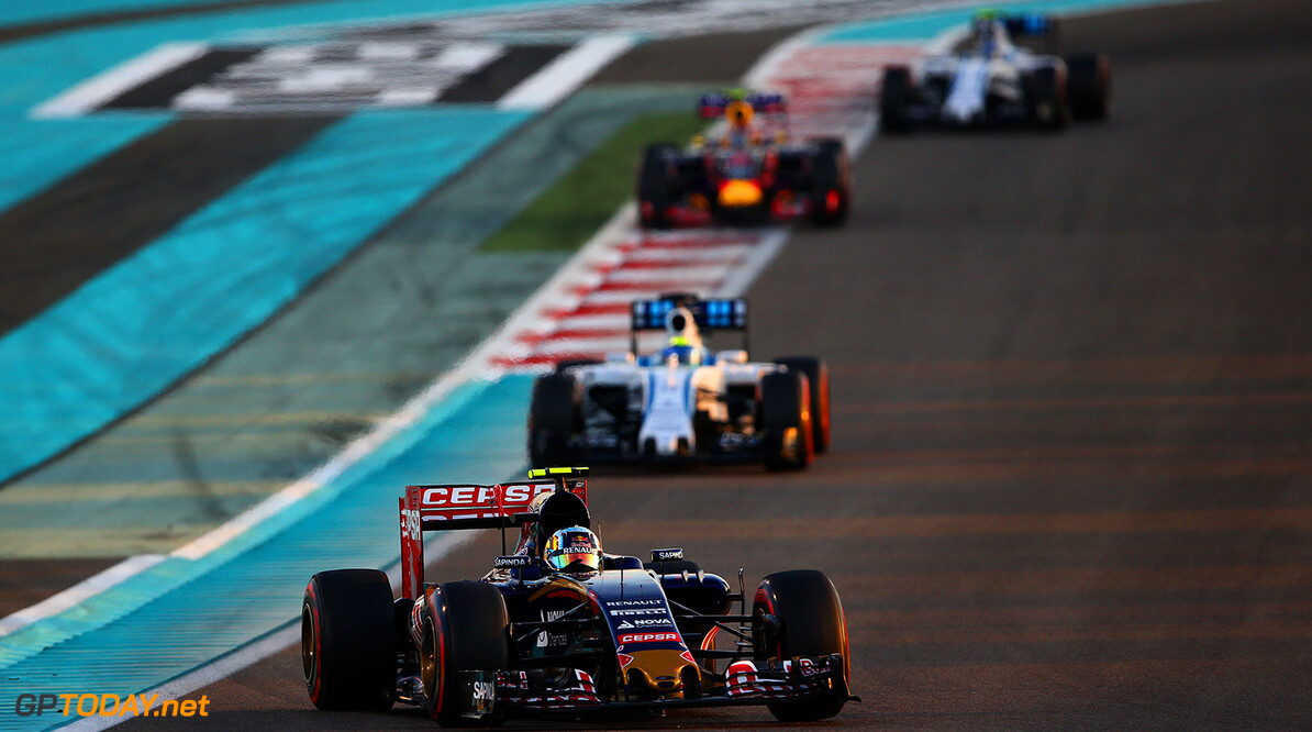 ABU DHABI, UNITED ARAB EMIRATES - NOVEMBER 29:  Carlos Sainz of Spain and Scuderia Toro Rosso drives ahead of Felipe Massa of Brazil and Williams  during the Abu Dhabi Formula One Grand Prix at Yas Marina Circuit on November 29, 2015 in Abu Dhabi, United Arab Emirates.  (Photo by Paul Gilham/Getty Images) // Getty Images/Red Bull Content Pool // P-20151129-00338 // Usage for editorial use only // Please go to www.redbullcontentpool.com for further information. //  F1 Grand Prix of Abu Dhabi Paul Gilham Abu Dhabi United Arab Emirates  P-20151129-00338