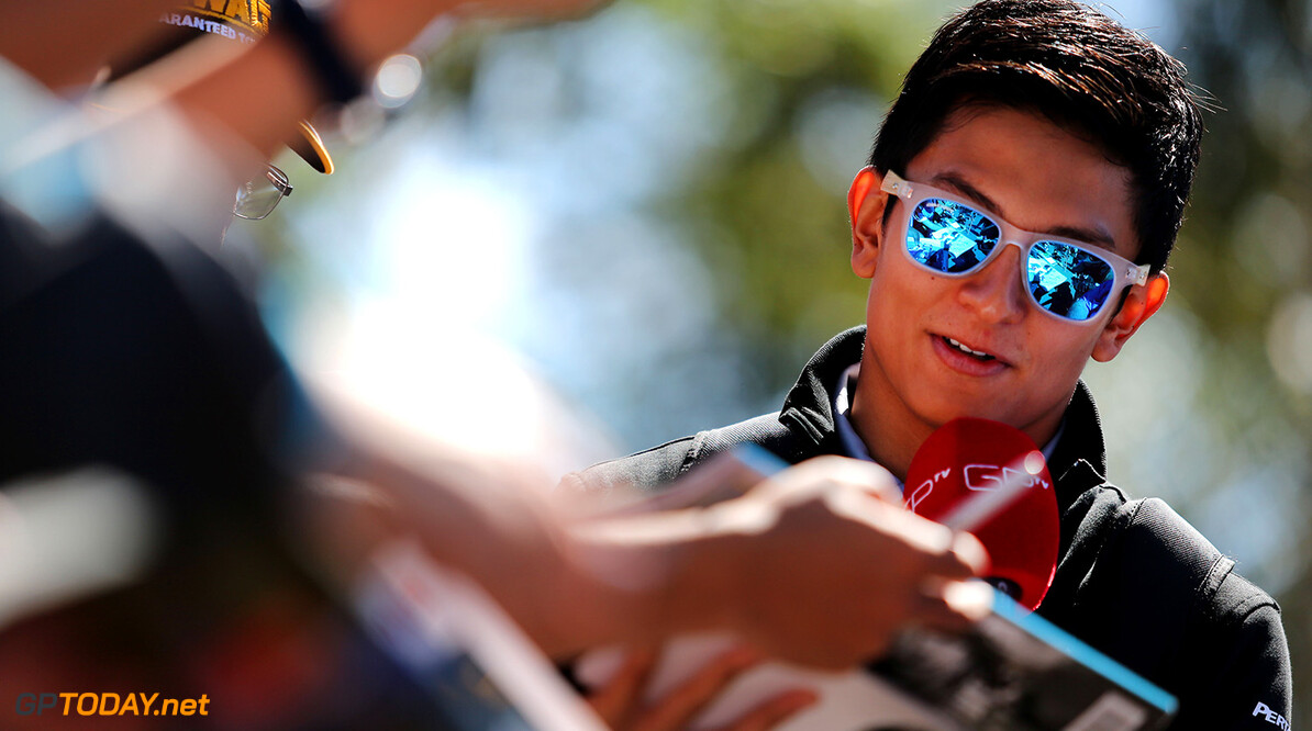 Formula One World Championship Rio Haryanto (IDN) Manor Racing signs autographs for the fans. 20.03.2016. Formula 1 World Championship, Rd 1, Australian Grand Prix, Albert Park, Melbourne, Australia, Race Day. Motor Racing - Formula One World Championship - Australian Grand Prix - Race Day - Melbourne, Australia Manor Racing Melbourne Australia  Formel1 Formel F1 Formula 1 Formula1 GP Grand Prix one March Australian Australia Albert Park Melbourne Oz Sunday 20 03 3 2016 Crowd Fans Spectators Audience Banner Portrait