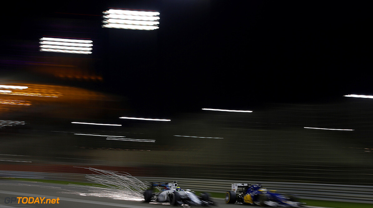 Bahrain International Circuit, Sakhir, Bahrain. Sunday 3 April 2016. Felipe Massa, Williams FW38 Mercedes passes Marcus Ericsson, Sauber C35 Ferrari. Photo: Glenn Dunbar/Williams F1 ref: Digital Image _W2Q6354      f1 formula 1 formula one bahraini bah gp grand prix action