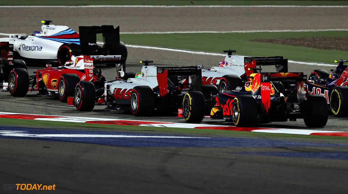 SAKHIR, BAHRAIN - APRIL 03: Daniil Kvyat of Russia drives the (26) Red Bull Racing Red Bull-TAG Heuer RB12 TAG Heuer battles with Esteban Gutierrez of Mexico drives the (21) Haas F1 Team Haas-Ferrari VF-16 Ferrari 059/5 turbo and Romain Grosjean of France drives the (8) Haas F1 Team Haas-Ferrari VF-16 Ferrari 059/5 turbo into the second corner during the Bahrain Formula One Grand Prix at Bahrain International Circuit on April 3, 2016 in Sakhir, Bahrain.  (Photo by Mark Thompson/Getty Images) // Getty Images / Red Bull Content Pool  // P-20160403-00115 // Usage for editorial use only // Please go to www.redbullcontentpool.com for further information. //  F1 Grand Prix of Bahrain Mark Thompson As Sakhir Bahrain  P-20160403-00115