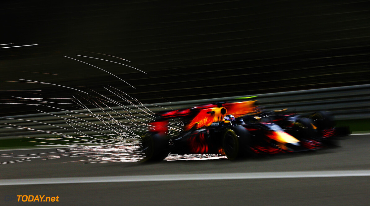 SAKHIR, BAHRAIN - APRIL 03: Daniel Ricciardo of Australia drives the (3) Red Bull Racing Red Bull-TAG Heuer RB12 TAG Heuer goes past Daniil Kvyat of Russia drives the (26) Red Bull Racing Red Bull-TAG Heuer RB12 TAG Heuer on track during the Bahrain Formula One Grand Prix at Bahrain International Circuit on April 3, 2016 in Sakhir, Bahrain.  (Photo by Mark Thompson/Getty Images) // Getty Images / Red Bull Content Pool  // P-20160403-00121 // Usage for editorial use only // Please go to www.redbullcontentpool.com for further information. //  F1 Grand Prix of Bahrain Mark Thompson As Sakhir Bahrain  P-20160403-00121