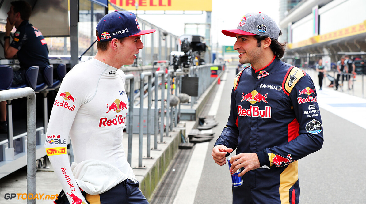 SHANGHAI, CHINA - APRIL 14: Carlos Sainz of Spain and Scuderia Toro Rosso and Max Verstappen of Netherlands and Scuderia Toro Rosso talk in the Pitlane during previews to the Formula One Grand Prix of China at Shanghai International Circuit on April 14, 2016 in Shanghai, China.  (Photo by Mark Thompson/Getty Images) // Getty Images / Red Bull Content Pool  // P-20160414-00144 // Usage for editorial use only // Please go to www.redbullcontentpool.com for further information. //  F1 Grand Prix of China - Previews Mark Thompson Shanghai China  P-20160414-00144