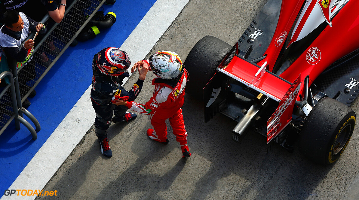 SHANGHAI, CHINA - APRIL 17:  Sebastian Vettel of Germany and Ferrari and Daniil Kvyat of Russia and Red Bull Racing shake hands in parc ferme during the Formula One Grand Prix of China at Shanghai International Circuit on April 17, 2016 in Shanghai, China.  (Photo by Clive Mason/Getty Images) // Getty Images / Red Bull Content Pool  // P-20160417-00219 // Usage for editorial use only // Please go to www.redbullcontentpool.com for further information. //  F1 Grand Prix of China Clive Mason Shanghai China  P-20160417-00219