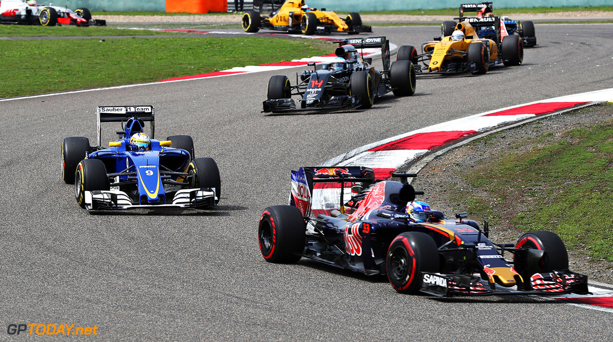 SHANGHAI, CHINA - APRIL 17: Max Verstappen of the Netherlands driving the (33) Scuderia Toro Rosso STR11 Ferrari 060/5 turbo leads Marcus Ericsson of Sweden driving the (9) Sauber F1 Team Sauber C35 Ferrari 059/5 turbo on track during the Formula One Grand Prix of China at Shanghai International Circuit on April 17, 2016 in Shanghai, China.  (Photo by Mark Thompson/Getty Images) // Getty Images / Red Bull Content Pool  // P-20160417-00395 // Usage for editorial use only // Please go to www.redbullcontentpool.com for further information. //  F1 Grand Prix of China Mark Thompson Shanghai China  P-20160417-00395