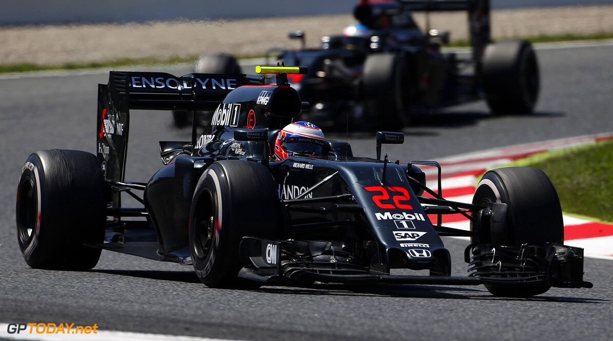 Jenson Button on track ahead of Fernando Alonso.