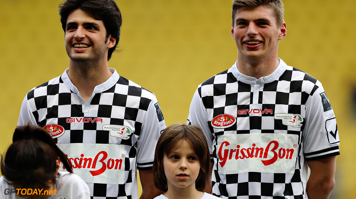MONTE-CARLO, MONACO - MAY 24:  Carlos Sainz of Spain and Scuderia Toro Rosso and Max Verstappen of Netherlands and Red Bull Racing line up for the match during the 24th World Stars football match at Stade Louis II, Monaco before the Monaco Formula One Grand Prix at Circuit de Monaco on May 24, 2016 in Monte-Carlo, Monaco.  (Photo by Lars Baron/Getty Images) // Getty Images / Red Bull Content Pool  // P-20160524-00779 // Usage for editorial use only // Please go to www.redbullcontentpool.com for further information. //  F1 Grand Prix of Monaco - Previews Lars Baron Monte-Carlo (City) Monaco  P-20160524-00779