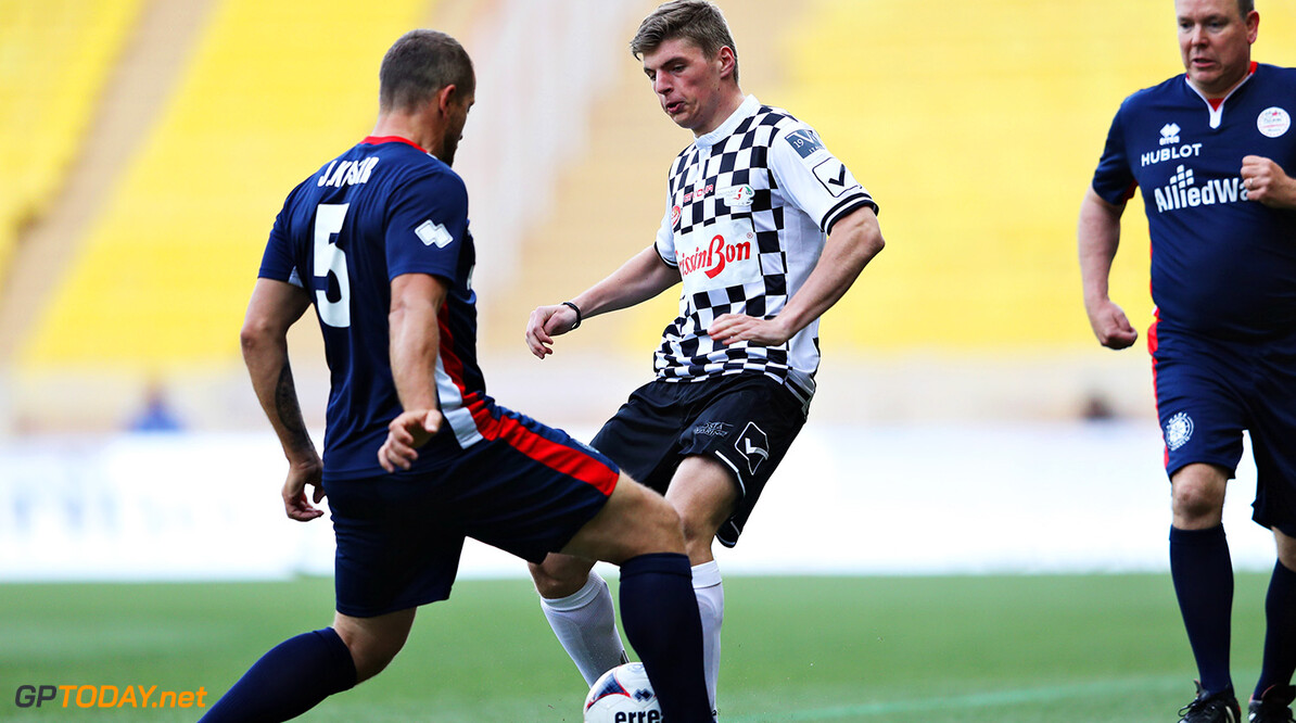 MONTE-CARLO, MONACO - MAY 24: Max Verstappen of Netherlands and Red Bull Racing runs with the ball during the 24th World Stars football match at Stade Louis II, Monaco before the Monaco Formula One Grand Prix at Circuit de Monaco on May 24, 2016 in Monte-Carlo, Monaco.  (Photo by Lars Baron/Getty Images) // Getty Images / Red Bull Content Pool  // P-20160524-00767 // Usage for editorial use only // Please go to www.redbullcontentpool.com for further information. //  F1 Grand Prix of Monaco - Previews Lars Baron Monte-Carlo (City) Monaco  P-20160524-00767