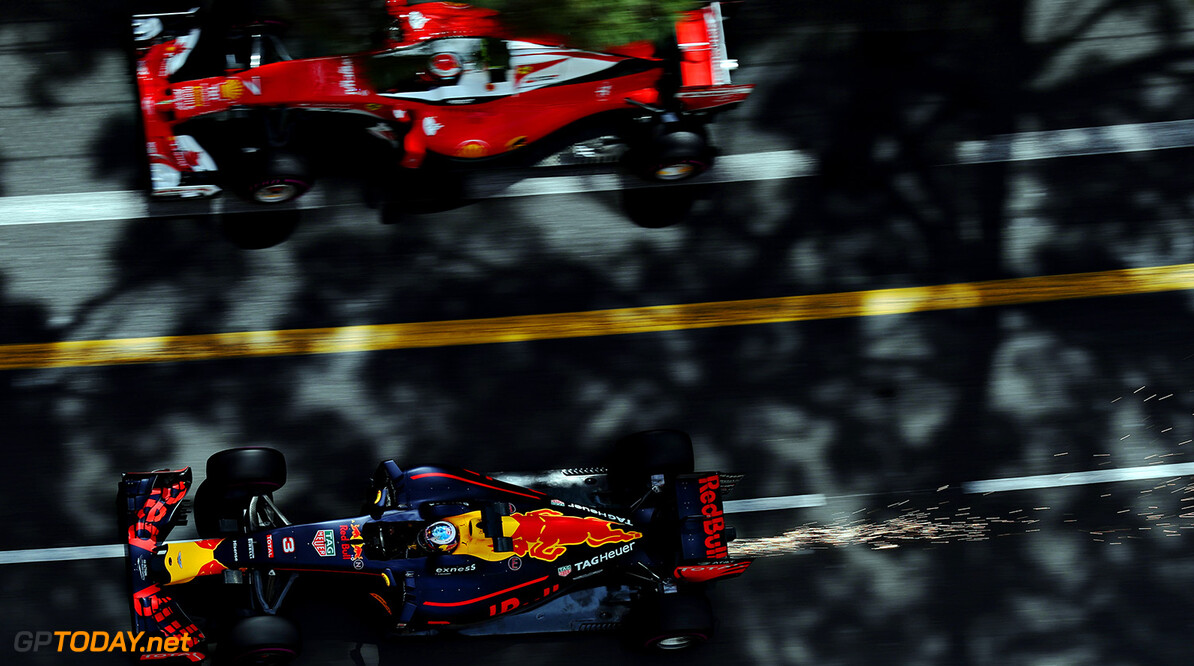 MONTE-CARLO, MONACO - MAY 26: Daniel Ricciardo of Australia driving the (3) Red Bull Racing Red Bull-TAG Heuer RB12 TAG Heuer drives past Kimi Raikkonen of Finland driving the (7) Scuderia Ferrari SF16-H Ferrari 059/5 turbo (Shell GP) on track during practice for the Monaco Formula One Grand Prix at Circuit de Monaco on May 26, 2016 in Monte-Carlo, Monaco.  (Photo by Mark Thompson/Getty Images) // Getty Images / Red Bull Content Pool  // P-20160526-00396 // Usage for editorial use only // Please go to www.redbullcontentpool.com for further information. //  F1 Grand Prix of Monaco - Practice Mark Thompson Monte-Carlo (City) Monaco  P-20160526-00396