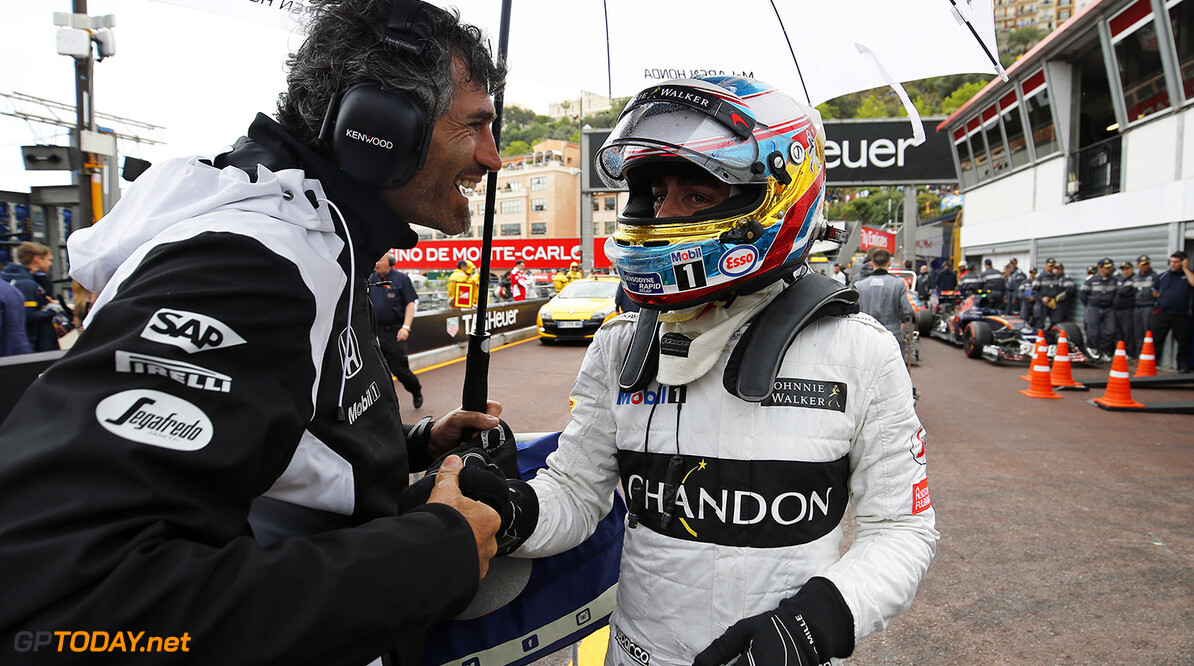 Fernando Alonso is congratulated after finishing in fifth place.