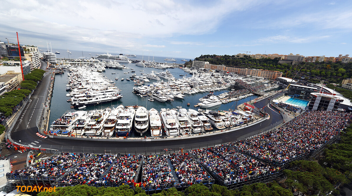 A scenic view of Monaco with Fernando Alonso on track.