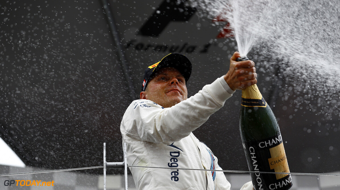 Circuit Gilles Villeneuve, Montreal, Canada. Sunday 12 June 2016. Valtteri Bottas, Williams Martini Racing, 3rd Position, sprays Champagne on the podium. Photo: Steven Tee/Williams ref: Digital Image _H7I6006      Portrait Podium