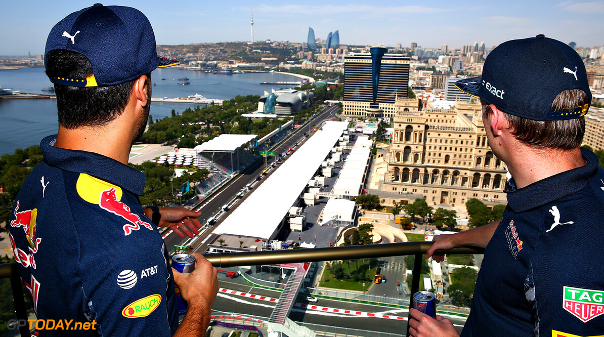 BAKU, AZERBAIJAN - JUNE 16:  Daniel Ricciardo of Australia and Red Bull Racing and Max Verstappen of Netherlands and Red Bull Racing look over the circuit during previews ahead of the European Formula One Grand Prix at Baku City Circuit on June 16, 2016 in Baku, Azerbaijan.  (Photo by Dan Istitene/Getty Images,) // Getty Images / Red Bull Content Pool  // P-20160616-00159 // Usage for editorial use only // Please go to www.redbullcontentpool.com for further information. //  European F1 Grand Prix - Previews Dan Istitene  Azerbaijan  P-20160616-00159