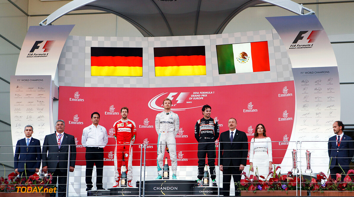 Formula One World Championship The podium (L to R): Sebastian Vettel (GER) Ferrari, second; Nico Rosberg (GER) Mercedes AMG F1, race winner; Sergio Perez (MEX) Sahara Force India F1, third. European Grand Prix, Sunday 19th June 2016. Baku City Circuit, Azerbaijan. Motor Racing - Formula One World Championship - European Grand Prix - Race Day - Baku, Azerbaijan James Moy Photography Baku Azerbaijan  Formula One Formula 1 F1 GP Grand Prix Circuit Europe European Baku Azerbaijan JM585 Winner  Victor Victory First Position First Place Sergio P?rez Sergio P?rez Mendoza Checo Perez Checo P?rez Portrait GP1608d
