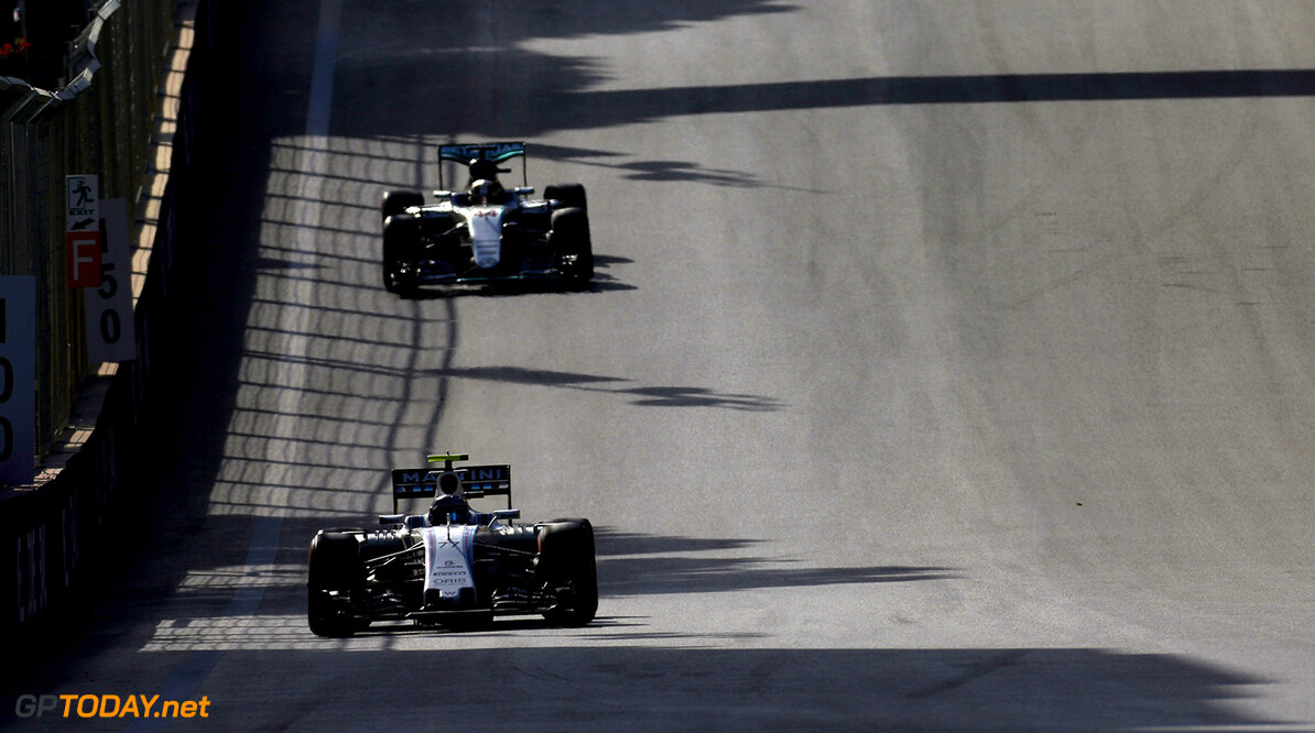 Baku City Circuit, Baku, Azerbaijan. Sunday 19 June 2016. Valtteri Bottas, Williams FW38 Mercedes, leads Lewis Hamilton, Mercedes F1 W07 Hybrid. Photo: Sam Bloxham/Williams ref: Digital Image _SBB5073  Al Staley    Action