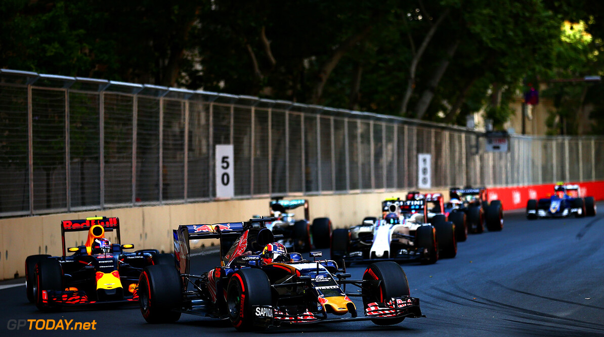 BAKU, AZERBAIJAN - JUNE 19: Daniil Kvyat of Russia driving the (26) Scuderia Toro Rosso STR11 Ferrari 060/5 turbo leads Max Verstappen of the Netherlands driving the (33) Red Bull Racing Red Bull-TAG Heuer RB12 TAG Heuer on track during the European Formula One Grand Prix at Baku City Circuit on June 19, 2016 in Baku, Azerbaijan.  (Photo by Dan Istitene/Getty Images) // Getty Images / Red Bull Content Pool  // P-20160619-00393 // Usage for editorial use only // Please go to www.redbullcontentpool.com for further information. //  European F1 Grand Prix Dan Istitene  Azerbaijan  P-20160619-00393