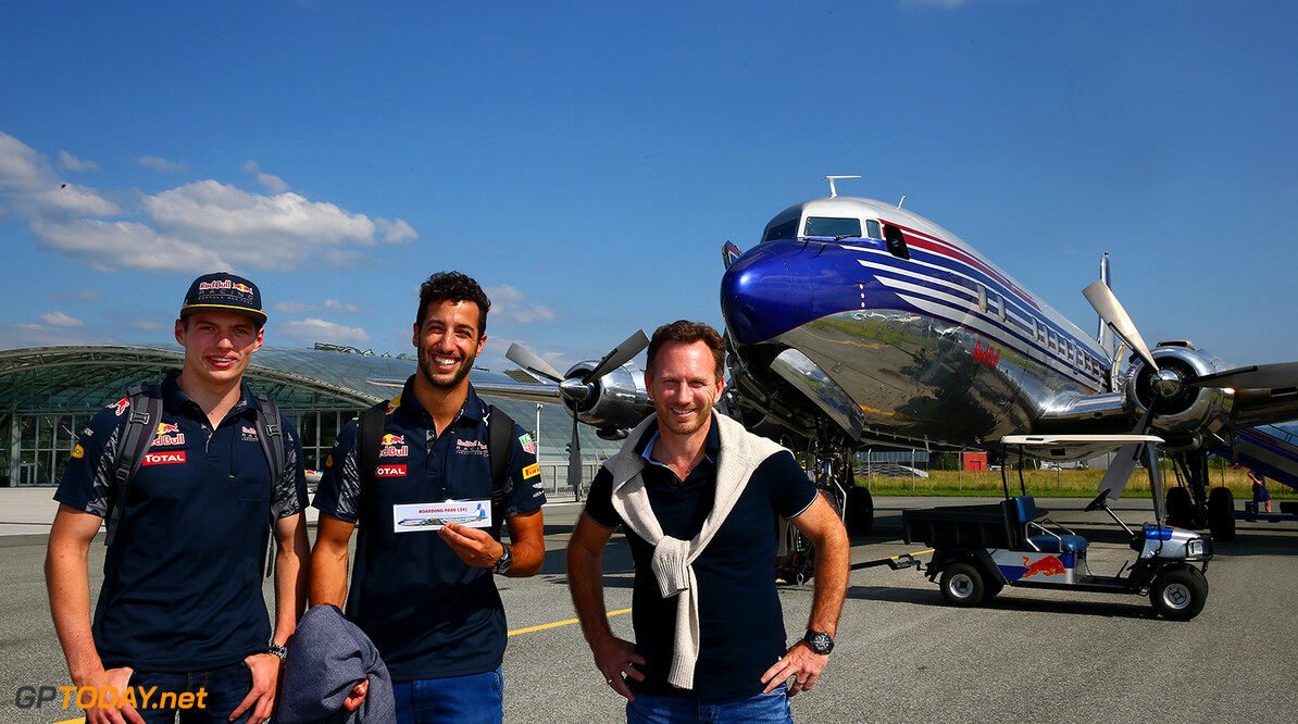 SALZBURG, AUSTRIA - JUNE 29:  Max Verstappen of Netherlands and Red Bull Racing, Daniel Ricciardo of Australia and Red Bull Racing and Red Bull Racing Team Principal Christian Horner pose before boarding the Red Bull Douglas DC-6B during a Red Bull Racing media flight to Hangar 7 on June 29, 2016 in Salzburg, Austria.  (Photo by Dan Istitene/Getty Images) // Getty Images/Red Bull Content Pool // P-20160629-00652 // Usage for editorial use only // Please go to www.redbullcontentpool.com for further information. //  Red Bull Racing Flight To Hangar 7 Dan Istitene Salzburg Austria  P-20160629-00652