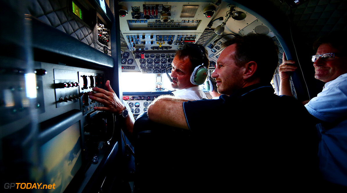 IN FLIGHT, AUSTRIA - JUNE 29:  Red Bull Racing Team Principal Christian Horner speaks with the pilots in the cockpit of the Red Bull Douglas DC-6B during a Red Bull Racing media flight to Hangar 7 on June 29, 2016 over Austria.  (Photo by Dan Istitene/Getty Images) // Getty Images/Red Bull Content Pool // P-20160629-00778 // Usage for editorial use only // Please go to www.redbullcontentpool.com for further information. //  Red Bull Racing Flight To Hangar 7 Dan Istitene Salzburg Austria  P-20160629-00778