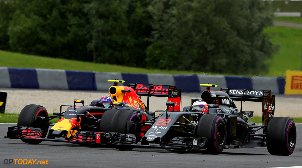 SPIELBERG, AUSTRIA - JULY 03: Max Verstappen of the Netherlands driving the (33) Red Bull Racing Red Bull-TAG Heuer RB12 TAG Heuer battles with Jenson Button of Great Britain driving the (22) McLaren Honda Formula 1 Team McLaren MP4-31 Honda RA616H Hybrid turbo on track during the Formula One Grand Prix of Austria at Red Bull Ring on July 3, 2016 in Spielberg, Austria.  (Photo by Charles Coates/Getty Images) // Getty Images / Red Bull Content Pool  // P-20160703-02492 // Usage for editorial use only // Please go to www.redbullcontentpool.com for further information. //  F1 Grand Prix of Austria Charles Coates Spielberg Germany  P-20160703-02492