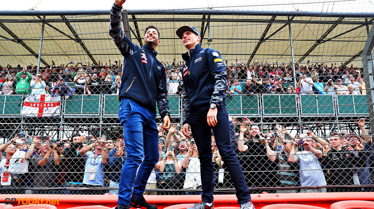 NORTHAMPTON, ENGLAND - JULY 07:  Daniel Ricciardo of Australia and Red Bull Racing and Max Verstappen of Netherlands and Red Bull Racing take a selfie with the fans during previews ahead of the Formula One Grand Prix of Great Britain at Silverstone on July 7, 2016 in Northampton, England.  (Photo by Mark Thompson/Getty Images) // Getty Images / Red Bull Content Pool  // P-20160707-01141 // Usage for editorial use only // Please go to www.redbullcontentpool.com for further information. //  F1 Grand Prix of Great Britain - Previews Mark Thompson Silverstone United Kingdom  P-20160707-01141