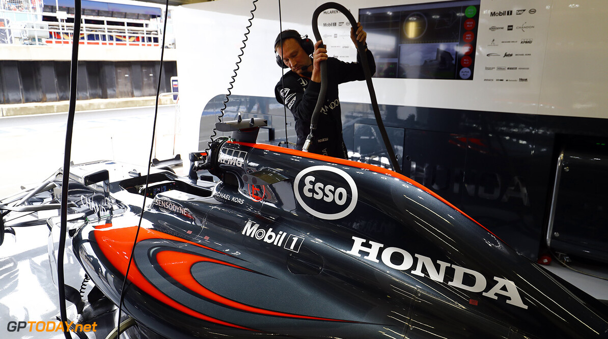 A team member works on the McLaren MP4-31 Honda of Fernando Alonso.
