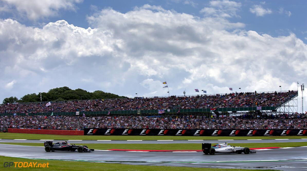 Silverstone, Northamptonshire, UK. Sunday 10 July 2016. Valtteri Bottas, Williams FW38 Mercedes, leads Jenson Button, McLaren MP4-31 Honda. Photo: Zak Mauger/Williams ref: Digital Image _79P8374  Zak Mauger    Action