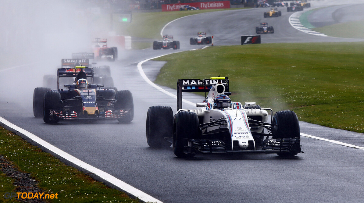 Silverstone, Northamptonshire, UK. Sunday 10 July 2016. Valtteri Bottas, Williams FW38 Mercedes, leads Carlos Sainz Jr, Toro Rosso STR11 Ferrari. Photo: Zak Mauger/Williams ref: Digital Image _79P8147      Action