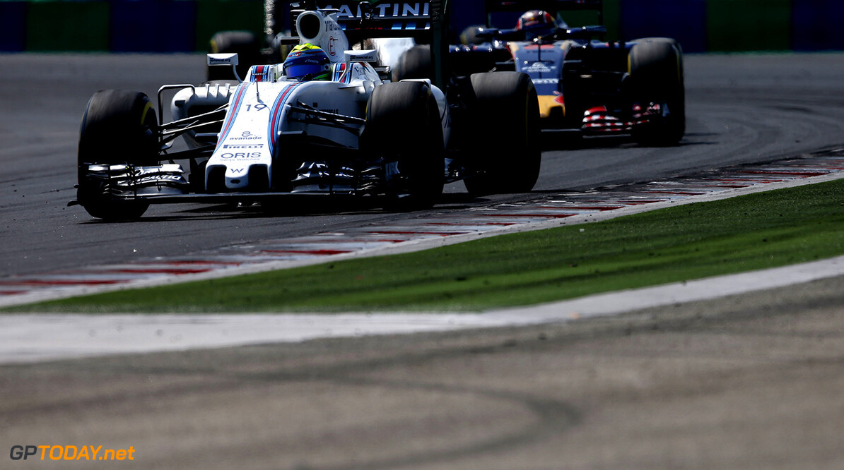 Hungaroring, Budapest, Hungary. Sunday 24 July 2016. Felipe Massa, Williams FW38 Mercedes, leads Daniil Kvyat, Toro Rosso STR11 Ferrari. Photo: Glenn Dunbar/Williams ref: Digital Image _W2Q7972      Action