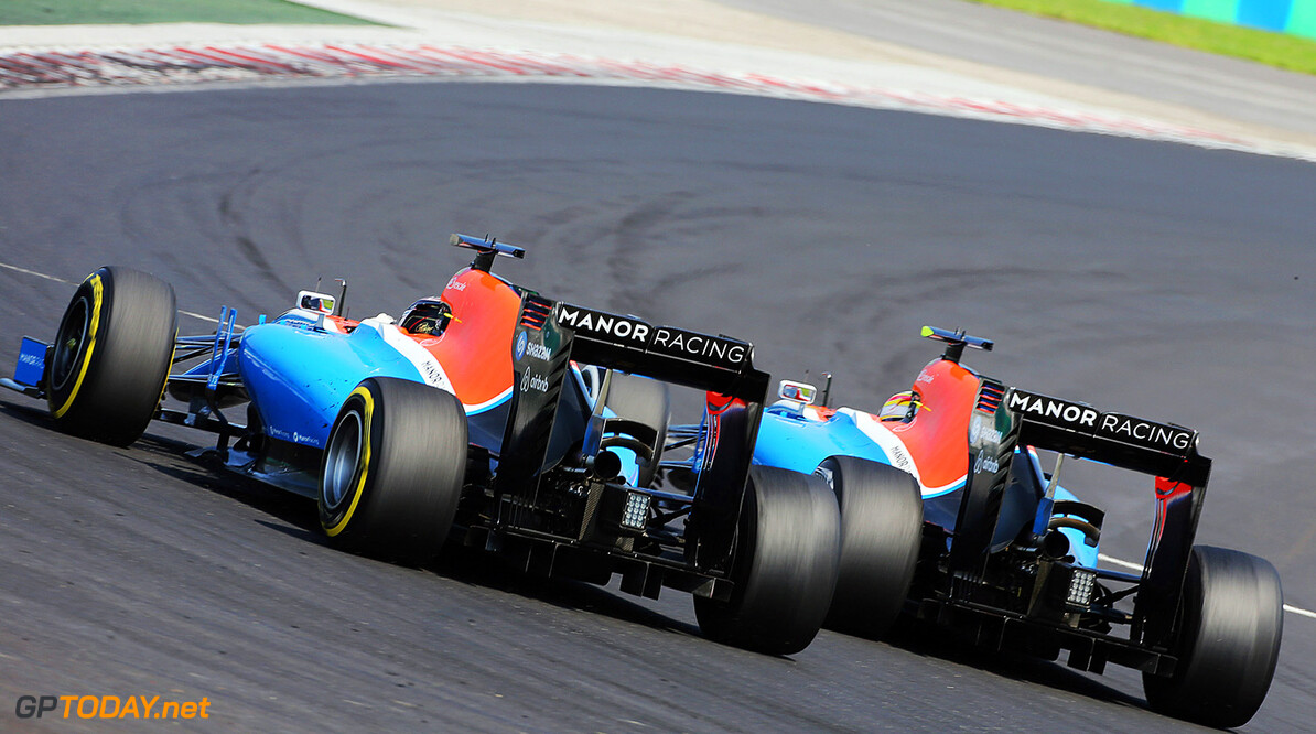 Formula One World Championship Pascal Wehrlein (GER) Manor Racing MRT05 and team mate Rio Haryanto (IDN) Manor Racing MRT05. 24.07.2016. Formula 1 World Championship, Rd 11, Hungarian Grand Prix, Budapest, Hungary, Race Day. Motor Racing - Formula One World Championship - Hungarian Grand Prix - Race Day - Budapest, Hungary Manor Racing Budapest Hungary  Formel1 Formel F1 Formula 1 Formula1 GP Grand Prix one Circuit July Hungary Hungarian Hungaroring Budapest Sunday 24 7 07 2016 Action Track