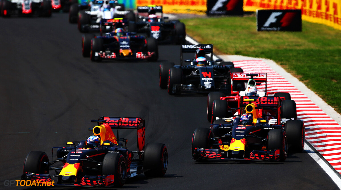 BUDAPEST, HUNGARY - JULY 24: Daniel Ricciardo of Australia driving the (3) Red Bull Racing Red Bull-TAG Heuer RB12 TAG Heuer leads Max Verstappen of the Netherlands driving the (33) Red Bull Racing Red Bull-TAG Heuer RB12 TAG Heuer on track during the Formula One Grand Prix of Hungary at Hungaroring on July 24, 2016 in Budapest, Hungary.  (Photo by Dan Istitene/Getty Images) // Getty Images / Red Bull Content Pool  // P-20160724-00349 // Usage for editorial use only // Please go to www.redbullcontentpool.com for further information. //  F1 Grand Prix of Hungary Dan Istitene Budapest Hungary  P-20160724-00349