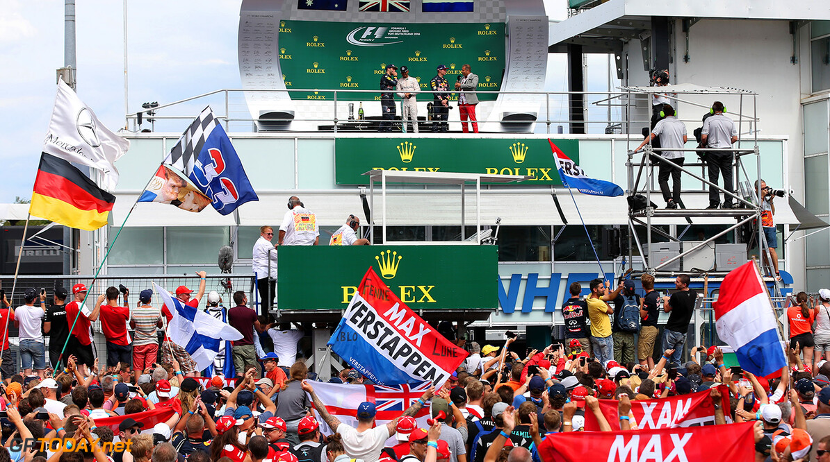 HOCKENHEIM, GERMANY - JULY 31:  Fans show their support as Lewis Hamilton of Great Britain and Mercedes GP, Daniel Ricciardo of Australia and Red Bull Racing and Max Verstappen of Netherlands and Red Bull Racing celebrate on the podium after the Formula One Grand Prix of Germany at Hockenheimring on July 31, 2016 in Hockenheim, Germany.  (Photo by Charles Coates/Getty Images) // Getty Images / Red Bull Content Pool  // P-20160731-00933 // Usage for editorial use only // Please go to www.redbullcontentpool.com for further information. //  F1 Grand Prix of Germany Charles Coates Hockenheim Germany  P-20160731-00933
