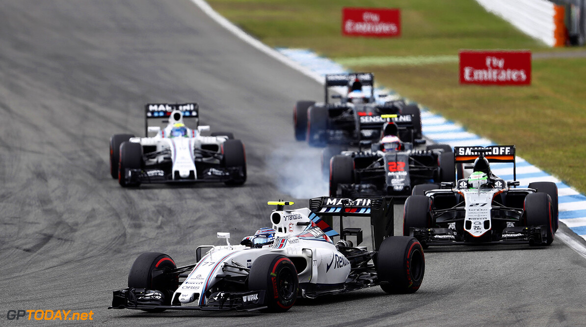 Hockenheim, Germany. Sunday 31 July 2016. Valtteri Bottas, Williams FW38 Mercedes, leads Nico Hulkenberg, Force India VJM09 Mercedes, Jenson Button, McLaren MP4-31 Honda, and Felipe Massa, Williams FW38 Mercedes. Photo: Glenn Dunbar/Williams ref: Digital Image _V2I6285      Action