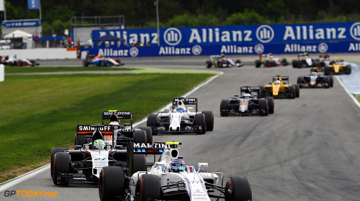 Hockenheim, Germany. Sunday 31 July 2016. Valtteri Bottas, Williams FW38 Mercedes, leads Nico Hulkenberg, Force India VJM09 Mercedes, Jenson Button, McLaren MP4-31 Honda, Felipe Massa, Williams FW38 Mercedes, and the reminder of the field on the opening lap. Photo: Steven Tee/Williams ref: Digital Image _H7I9976      Action Start