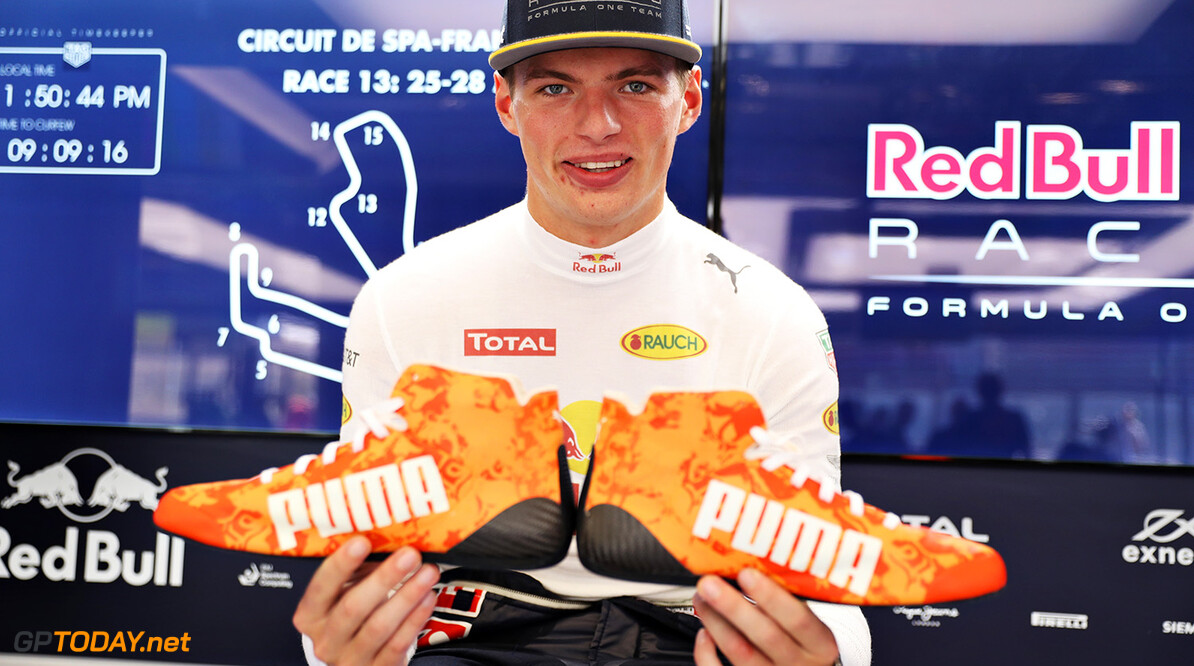 SPA, BELGIUM - AUGUST 25:  Max Verstappen of Netherlands and Red Bull Racing with his new orange racing boots in the Red Bull Racing garage during previews ahead of the Formula One Grand Prix of Belgium at Circuit de Spa-Francorchamps on August 25, 2016 in Spa, Belgium.  (Photo by Mark Thompson/Getty Images) // Getty Images / Red Bull Content Pool  // P-20160825-00828 // Usage for editorial use only // Please go to www.redbullcontentpool.com for further information. //  F1 Grand Prix of Belgium - Previews Mark Thompson Spa Belgium  P-20160825-00828