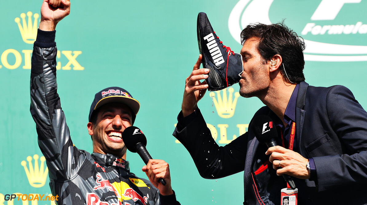 SPA, BELGIUM - AUGUST 28:  Mark Webber drinks champagne from the boot of Daniel Ricciardo of Australia and Red Bull Racing on the podium during the Formula One Grand Prix of Belgium at Circuit de Spa-Francorchamps on August 28, 2016 in Spa, Belgium  (Photo by Mark Thompson/Getty Images) // Getty Images / Red Bull Content Pool  // P-20160828-01510 // Usage for editorial use only // Please go to www.redbullcontentpool.com for further information. //  F1 Grand Prix of Belgium Mark Thompson Spa Belgium  P-20160828-01510