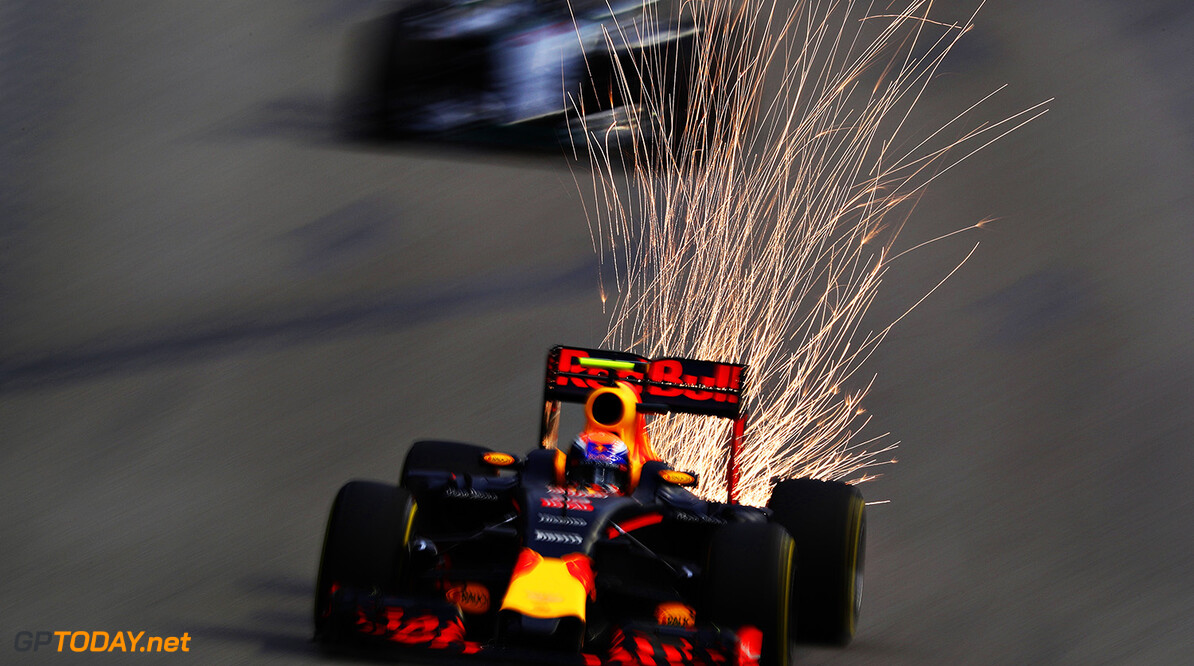SINGAPORE - SEPTEMBER 17: Sparks fly behind Max Verstappen of the Netherlands driving the (33) Red Bull Racing Red Bull-TAG Heuer RB12 TAG Heuer on track during final practice for the Formula One Grand Prix of Singapore at Marina Bay Street Circuit on September 17, 2016 in Singapore.  (Photo by Clive Mason/Getty Images) *** BESTPIX *** // Getty Images / Red Bull Content Pool  // P-20160918-02618 // Usage for editorial use only // Please go to www.redbullcontentpool.com for further information. //  *** BESTPIX *** F1 Grand Prix of Singapore - Qualifying Clive Mason Singapore Singapore  P-20160918-02618