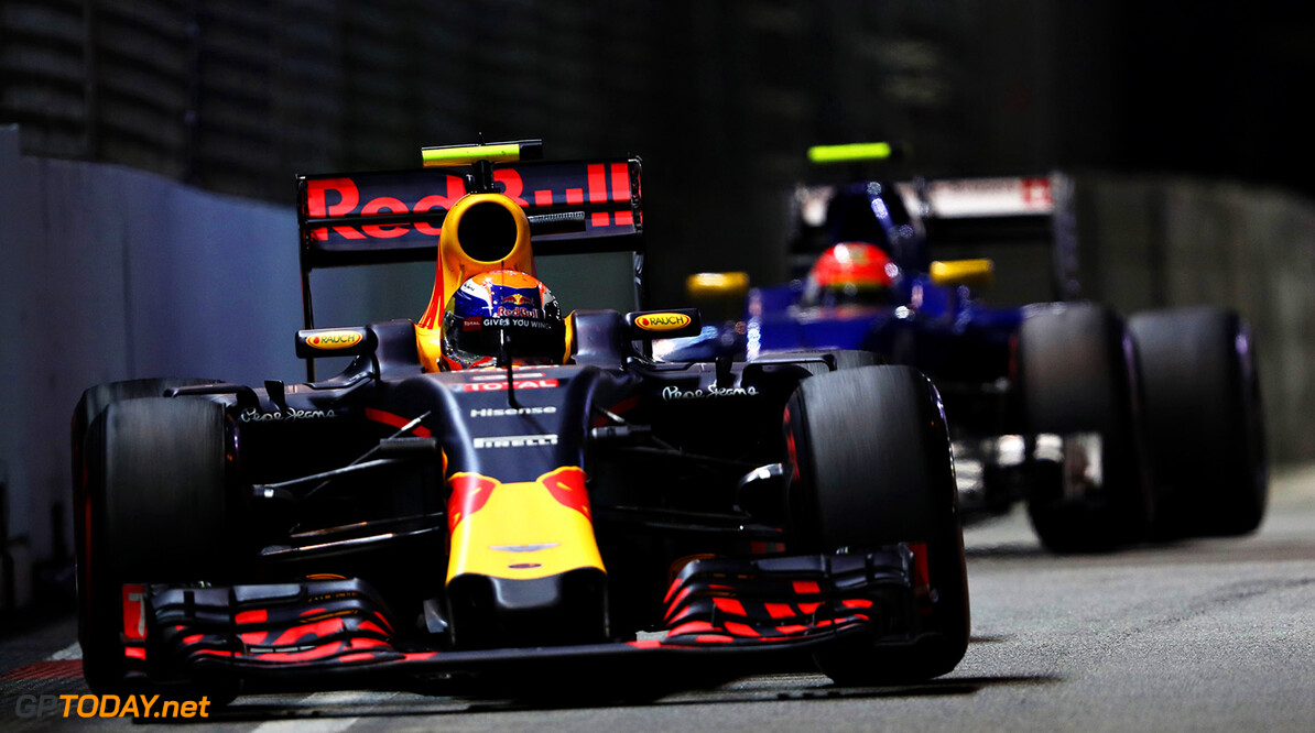 SINGAPORE - SEPTEMBER 18: Max Verstappen of the Netherlands driving the (33) Red Bull Racing Red Bull-TAG Heuer RB12 TAG Heuer leads Felipe Nasr of Brazil driving the (12) Sauber F1 Team Sauber C35 Ferrari 059/5 turbo on track during the Formula One Grand Prix of Singapore at Marina Bay Street Circuit on September 18, 2016 in Singapore.  (Photo by Mark Thompson/Getty Images) // Getty Images / Red Bull Content Pool  // P-20160918-01057 // Usage for editorial use only // Please go to www.redbullcontentpool.com for further information. //  F1 Grand Prix of Singapore Mark Thompson Singapore Singapore  P-20160918-01057