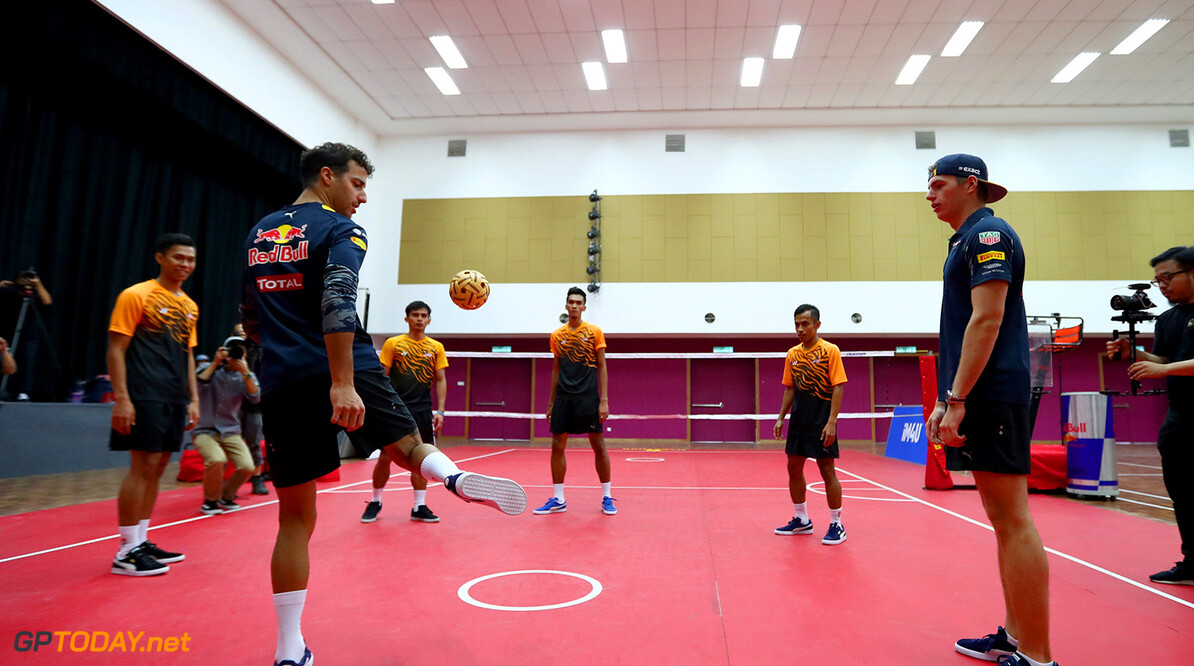 PUCHONG, MALAYSIA - SEPTEMBER 28:  Daniel Ricciardo of Australia and Red Bull Racing and Max Verstappen of Netherlands and Red Bull Racing play Malaysian sport sepak takraw at the iM4U Sentral in Puchong during previews for the Malaysia Formula One Grand Prix at Sepang Circuit on September 28, 2016 in Kuala Lumpur, Malaysia.  (Photo by Clive Rose/Getty Images) // Getty Images / Red Bull Content Pool  // P-20160928-05782 // Usage for editorial use only // Please go to www.redbullcontentpool.com for further information. //  F1 Grand Prix of Malaysia - Previews Clive Rose Kuala Lumpur Malaysia  P-20160928-05782