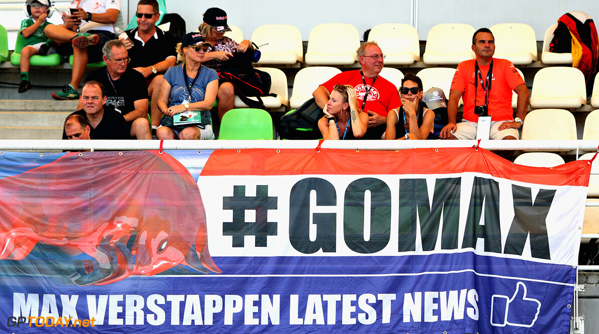 KUALA LUMPUR, MALAYSIA - SEPTEMBER 30: Max Verstappen of Netherlands and Red Bull Racing fans watch the action in a grandstand during practice for the Malaysia Formula One Grand Prix at Sepang Circuit on September 30, 2016 in Kuala Lumpur, Malaysia.  (Photo by Mark Thompson/Getty Images) // Getty Images / Red Bull Content Pool  // P-20160930-00288 // Usage for editorial use only // Please go to www.redbullcontentpool.com for further information. //  F1 Grand Prix of Malaysia - Practice Mark Thompson Kuala Lumpur Malaysia  P-20160930-00288