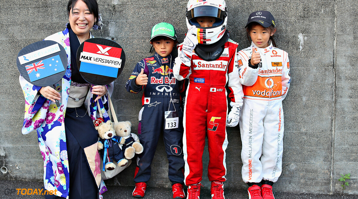SUZUKA, JAPAN - OCTOBER 06: Fans supporting Red Bull Racing, Ferrari and McLaren during previews ahead of the Formula One Grand Prix of Japan at Suzuka Circuit on October 6, 2016 in Suzuka.  (Photo by Mark Thompson/Getty Images) // Getty Images / Red Bull Content Pool  // P-20161006-01573 // Usage for editorial use only // Please go to www.redbullcontentpool.com for further information. //  F1 Grand Prix of Japan - Previews Mark Thompson Suzuka Japan  P-20161006-01573