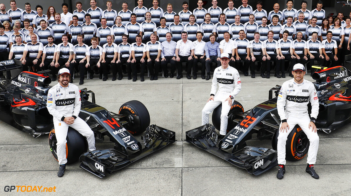 A team group photo. Fernando Alonso, Stoffel Vandoorne and Jenson pose with their McLaren MP4-31 Hondas in front of the assembled team.