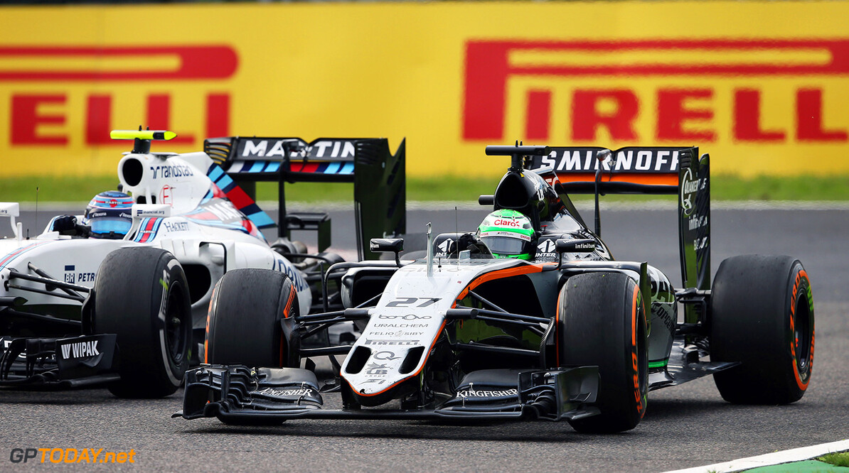 Formula One World Championship Nico Hulkenberg (GER) Sahara Force India F1 VJM09 and Valtteri Bottas (FIN) Williams FW38 battle for position. Japanese Grand Prix, Sunday 9th October 2016. Suzuka, Japan. Motor Racing - Formula One World Championship - Japanese Grand Prix - Race Day - Suzuka, Japan James Moy Photography Suzuka Japan  Formula One Formula 1 F1 GP Grand Prix Circuit Japan Japanese Suzuka JM637 Hulkenberg H?lkenberg Huelkenberg Action Track GP1617d