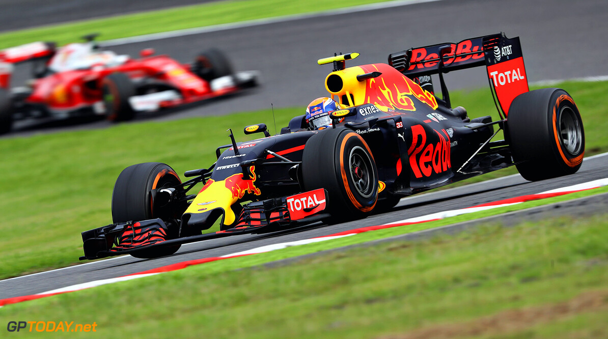 SUZUKA, JAPAN - OCTOBER 09: Max Verstappen of the Netherlands driving the (33) Red Bull Racing Red Bull-TAG Heuer RB12 TAG Heuer leads Sebastian Vettel of Germany driving the (5) Scuderia Ferrari SF16-H Ferrari 059/5 turbo (Shell GP) on track during the Formula One Grand Prix of Japan at Suzuka Circuit on October 9, 2016 in Suzuka.  (Photo by Mark Thompson/Getty Images) // Getty Images / Red Bull Content Pool  // P-20161009-01051 // Usage for editorial use only // Please go to www.redbullcontentpool.com for further information. //  F1 Grand Prix of Japan Mark Thompson Suzuka Japan  P-20161009-01051
