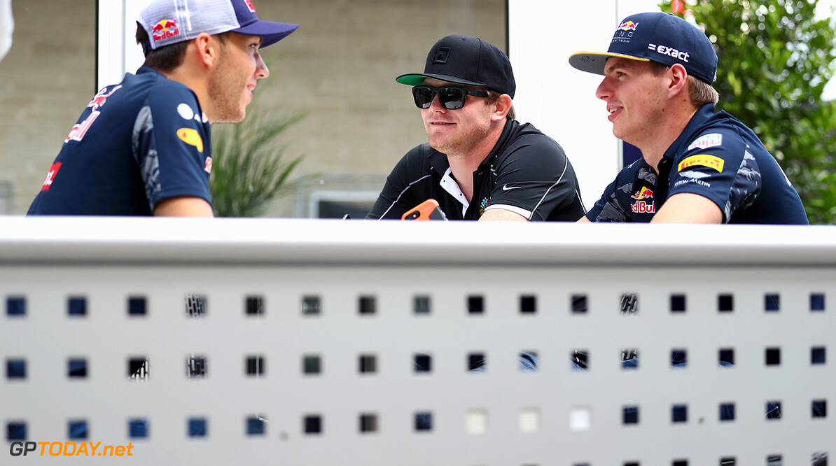 AUSTIN, TX - OCTOBER 20:  Max Verstappen of Netherlands and Red Bull Racing talks with IndyCar driver Conor Daly of United States and Pierre Gasly of France and Red Bull Racing in the Paddock during previews ahead of the United States Formula One Grand Prix at Circuit of The Americas on October 20, 2016 in Austin, United States.  (Photo by Clive Mason/Getty Images) // Getty Images / Red Bull Content Pool  // P-20161020-01555 // Usage for editorial use only // Please go to www.redbullcontentpool.com for further information. //  F1 Grand Prix of USA - Previews Clive Mason Austin United States  P-20161020-01555