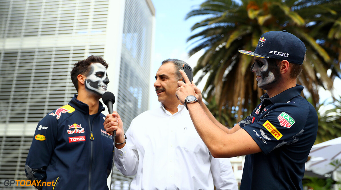 MEXICO CITY, MEXICO - OCTOBER 27:  Daniel Ricciardo of Australia and Red Bull Racing talks to the media in the Paddock while Max Verstappen of Netherlands and Red Bull Racing takes a photo, both in full Dia de Muertos face paint during previews to the Formula One Grand Prix of Mexico at Autodromo Hermanos Rodriguez on October 27, 2016 in Mexico City, Mexico.  (Photo by Clive Mason/Getty Images) // Getty Images / Red Bull Content Pool  // P-20161027-01664 // Usage for editorial use only // Please go to www.redbullcontentpool.com for further information. //  F1 Grand Prix of Mexico - Previews Clive Mason    P-20161027-01664